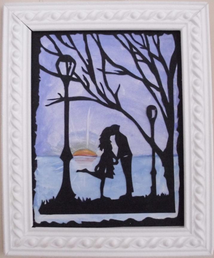 Романтичная работа - влюбленная пара при закате солнца